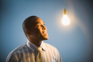 Businessman Looking at Lightbulb